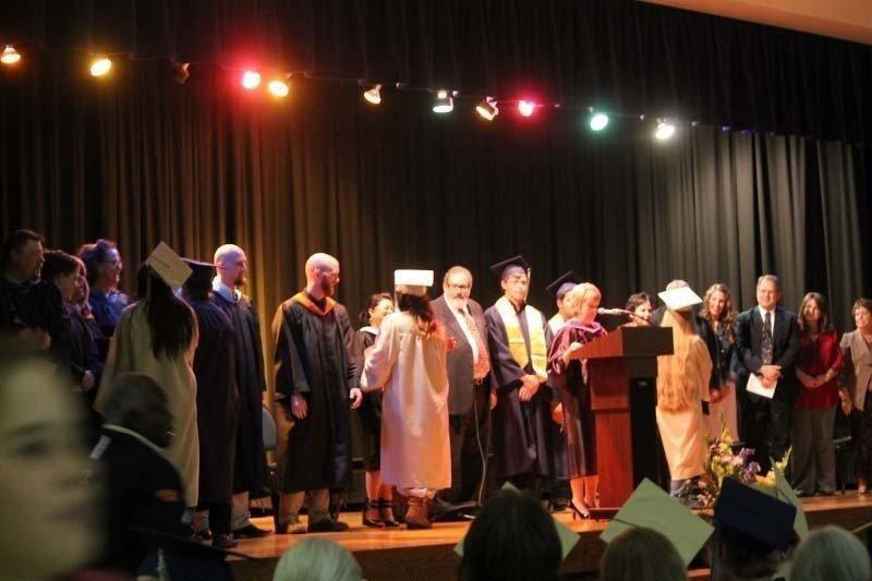 Graduates-greet-line-and-receive-diplomas.jpg