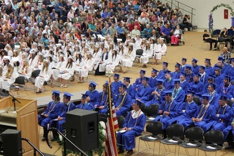 Graduates-listen-attentively.jpg