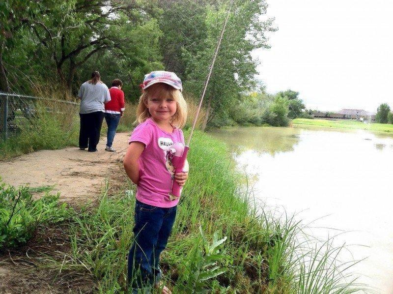 Kayda-poses-for-a-picture-at-the-Green-River-fishing-event-on-9-14-13.jpg