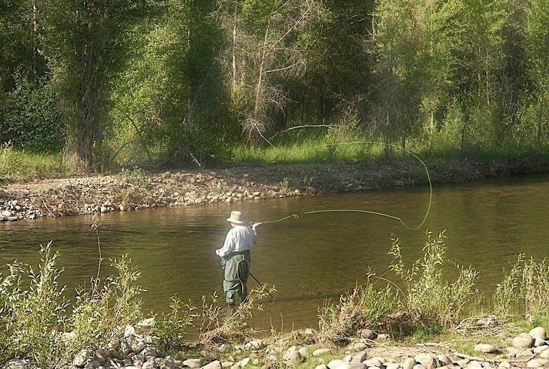 kirk_gardner_angler_flyfishing_on_a_river.jpg