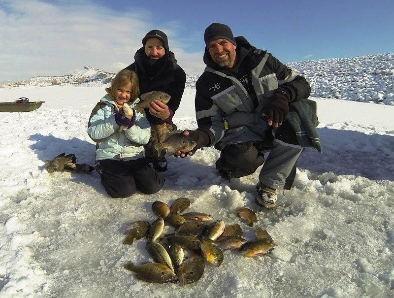 ryan_mosley_12-30-2015_ice_anglers_show_bluegill_and_largemouth_bass_they_caught_at_Steinaker_Reservoir.jpg