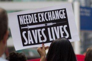 Needle-Exchange-Saves-Lives-protes-CROPPEDt-300x199.jpg