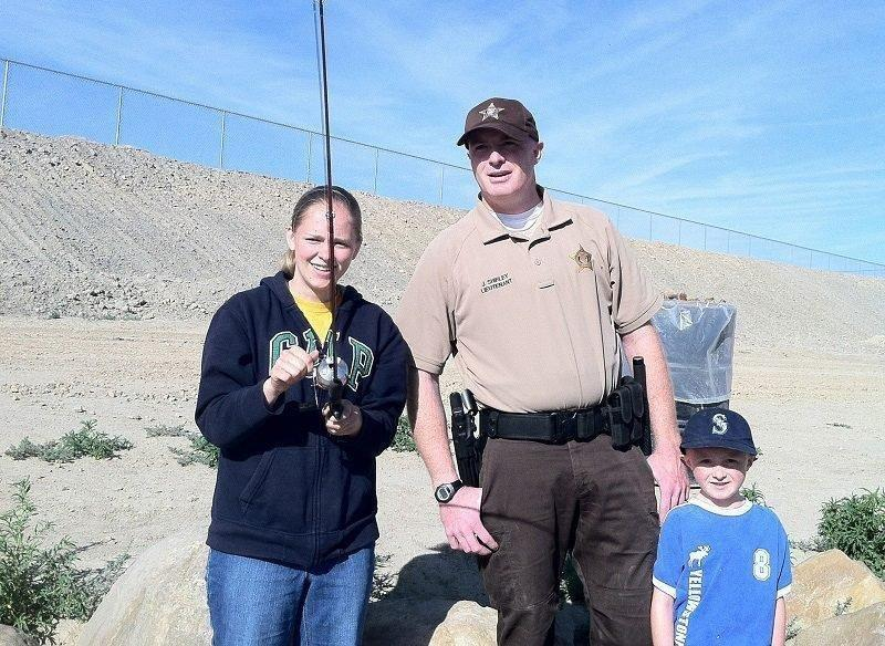 brent_stettler_2014_anglers_fish_with_DWR_Lieutenant_Justin_Shirley_at_Cops-Badges-Bobbers_event_at_the_Carbon_County_Community_Fishing_Pond.jpg