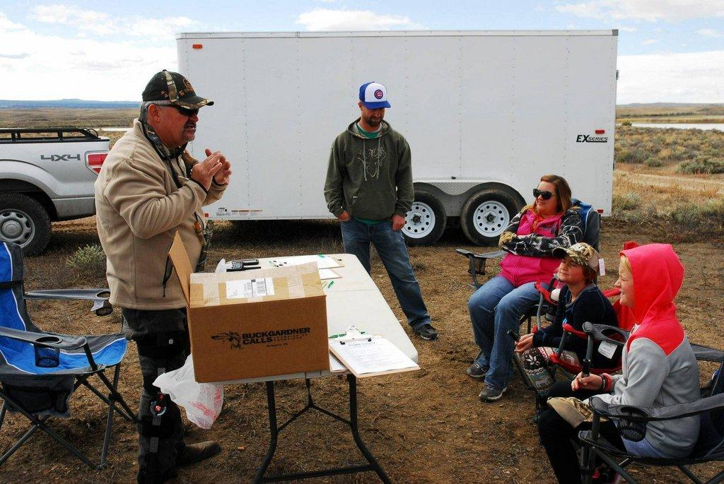 morgan_jacobsen_9-2016_DWR_Regional_Wildlife_Recreation_Specialist_Walt_Maldonado_teaches_kids_how_to_call_ducks_at_waterfowl_clinic_in_southeastern_Utah_1.jpg