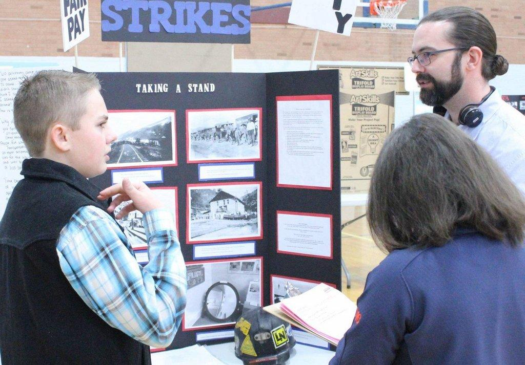 Student-talks-about-his-history-display-with-judges-at-last-years-history-fair.jpg