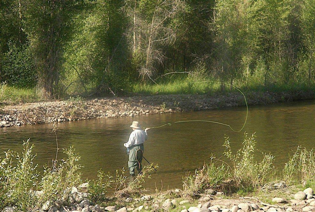 kirk_gardner_angler_flyfishing_on_a_river.jpg
