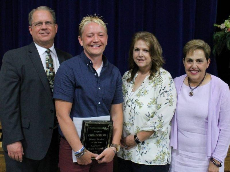 Carbon-School-Board-members-Jeff-Richens-Lee-McCourt-and-Kristen-Taylor-stand-by-Teacher-of-the-Year-Cami-Carlson-during-the-Awards-Banquet..jpg