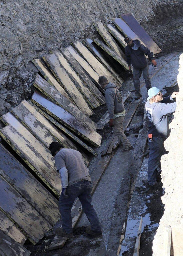 Workers-toil-to-install-reinforcements-for-retaining-wall..jpg
