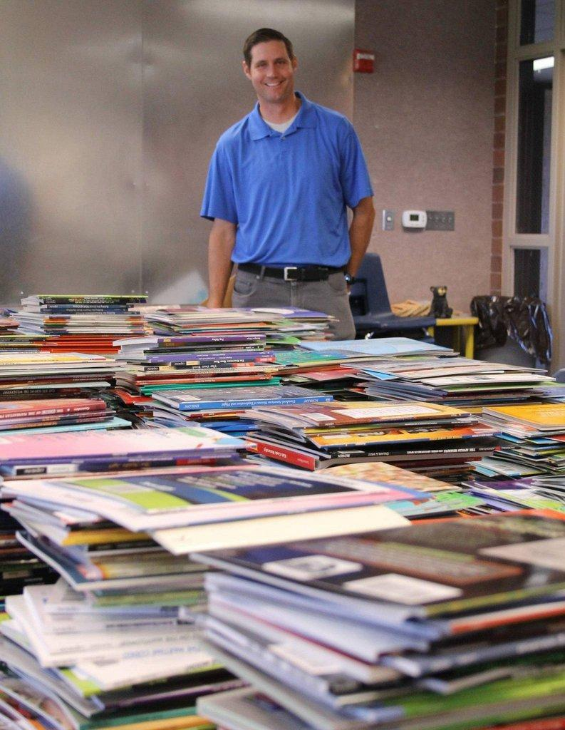 Chris-Winfree-in-front-of-leveled-books.jpg