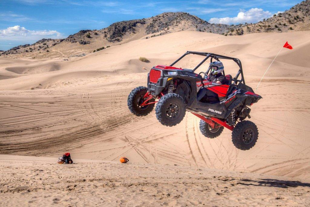 A-man-jumps-his-OHV-off-a-sand-dune-at-Little-Sahara-Recreation-Area.-Photo-by-Bob-Wick-BLM.-scaled.jpg