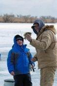 ron_2011_nick_stewart_and_ed_johnson_ice_fishing_at_pelican_lake.jpg
