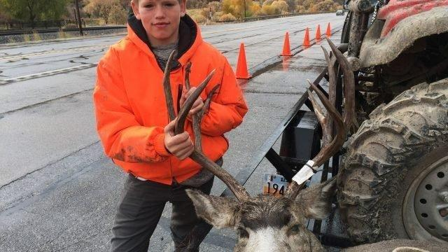 scott_root_10-20-2018_Devin_Allen_at_the_Spanish_Fork_check_station_in_north-central_Utah_shows_the_first_buck_hes_ever_taken.jpg